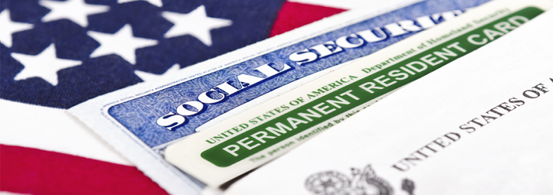 image of United States flag, social security card and visa