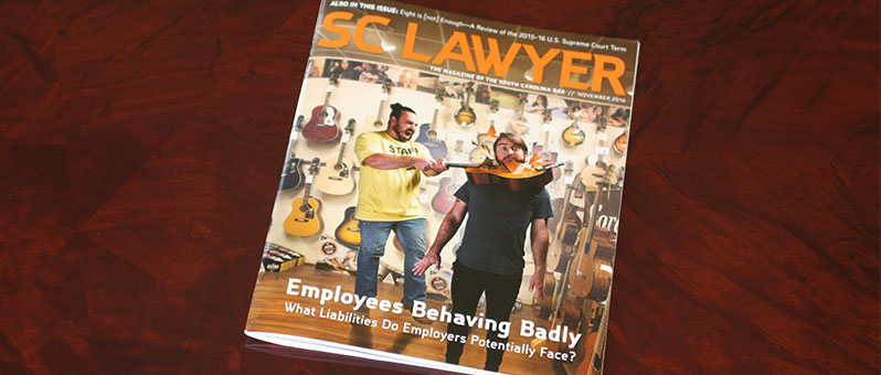 photo of cover of SC Lawyer magazine with image of one employee breaking a guitar over a man's head for employer liability article
