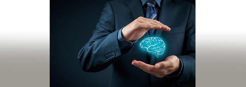 image of the hands of a businessman cradling a graphic image of a brain, to illustrate protecting intellectual property